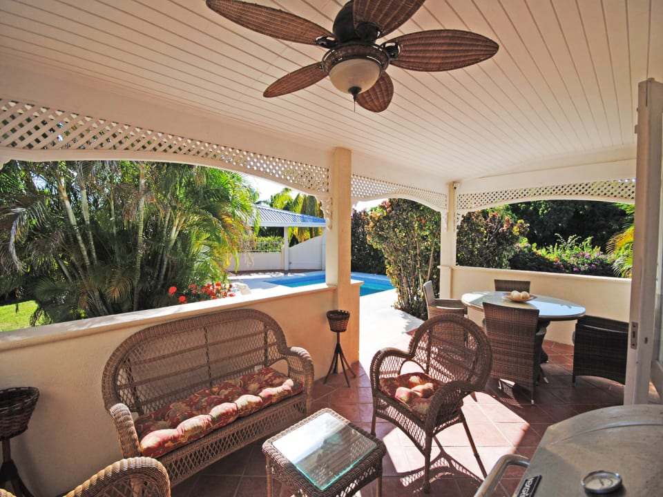 Covered veranda leads to pool