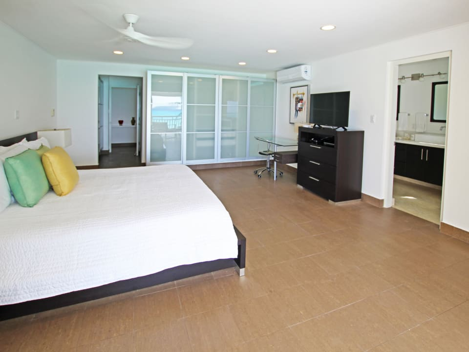 Main bedroom with patio access