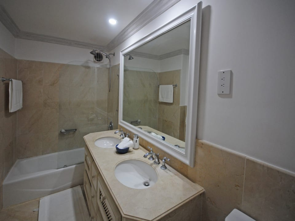 Bathroom two has a double vanity and tub shower