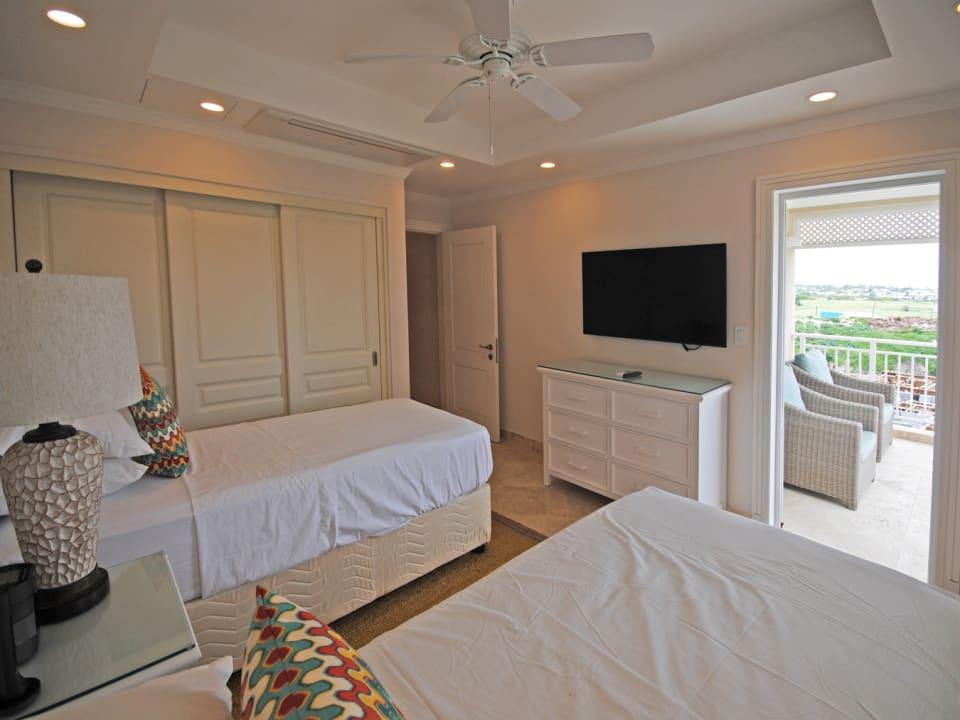 Bedroom 3 twin bedroom opens to shared terrace