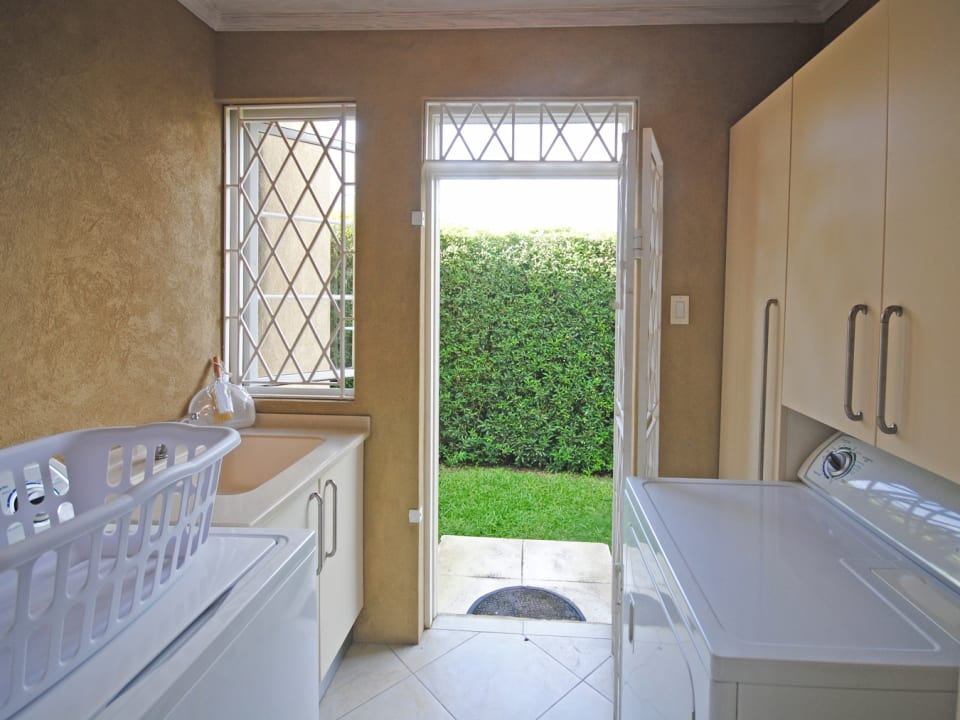 Laundry room opens to back garden