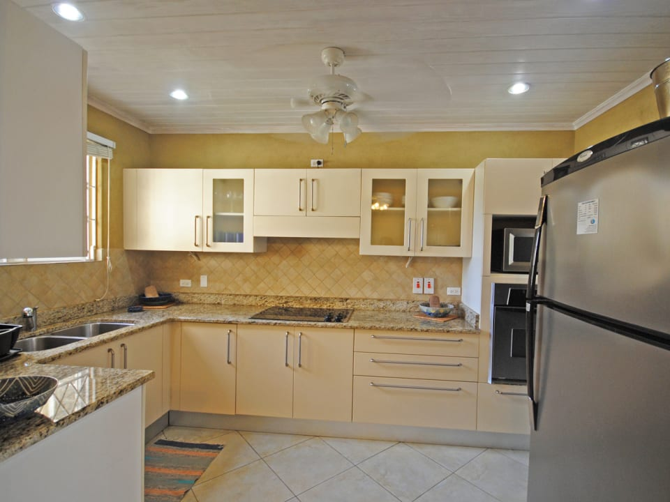 Well equipped kitchen has granite counter tops