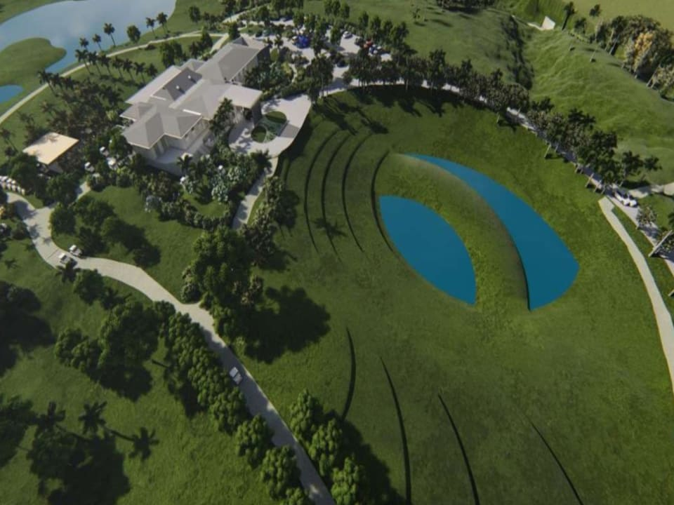 Aerial view showing clubhouse, half way house and 19th hole lake island green