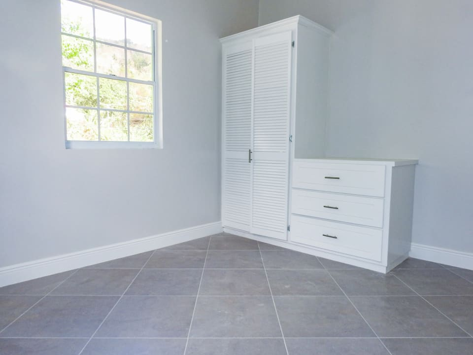 Bedroom with built-in closet