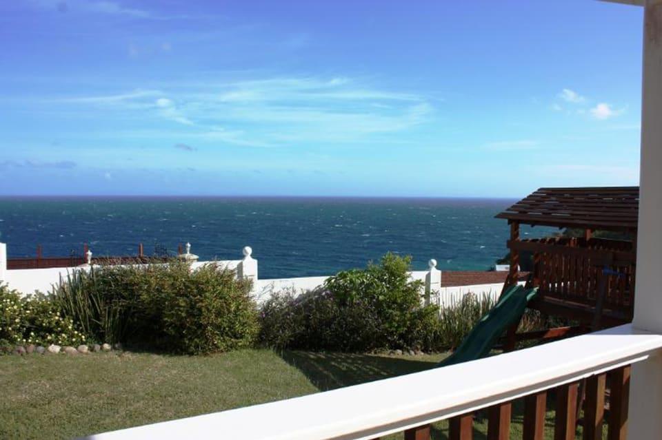 View of ocean and backyard