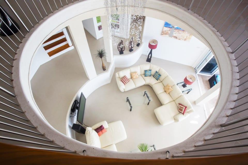 First Floor looking down towards he sunken living room on the ground floor