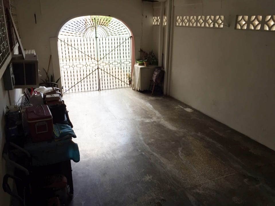 view of the enclosed garage from the kitchen stairs