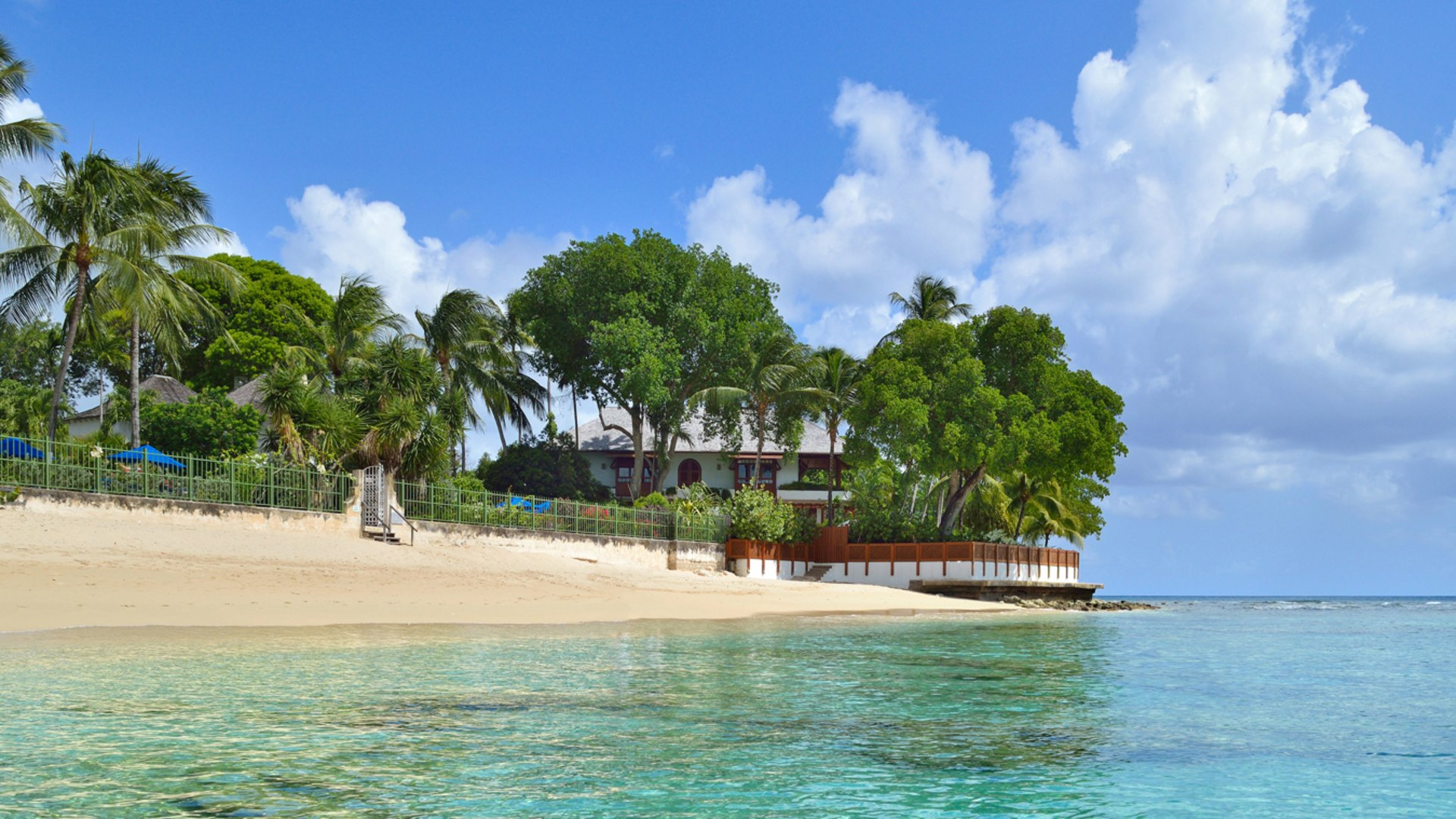 Located on the point of Gibbs Beach & Carlton Bay
