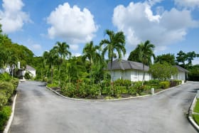 Photo taken from entrance with cottage on left and main house on right