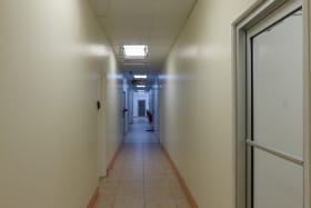 Corridor to the shared bathroom and lunch room