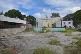 Lot with existing derelict buildings