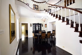 Dining Room and Curved Stairwell