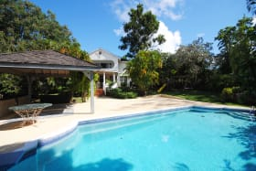 Swimming pool with poolside gazebo and deck