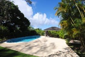 Pool with large deck and poolside gazebo