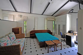 Main room leads to pool courtyard and laundry