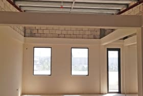 Slightly vaulted ceilings to the eastern side of the unit