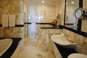 Marble lined master bathroom