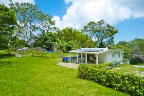 Home set within tropical garden