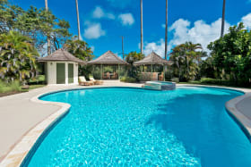 Inviting swimming pool with bar and dining gazebo