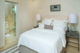 Guest bedroom 1 with doors opening on to pool terrace