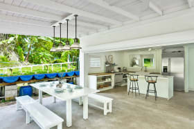 Modern kitchen leads out to a large covered patio