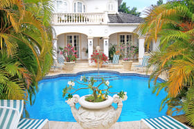 View of swimming pool and house from sun terrace