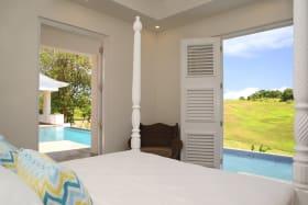 Master bedroom overlooking pool and country views