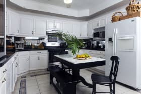 Kitchen with grey/black quartz countertops & Breakfast Bar