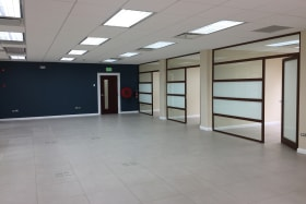 2nd floor open plan space with 7 private offices