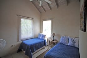Twin bedroom upstairs with ceiling fan