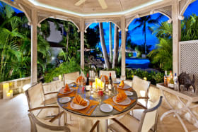 Dining terrace overlooking the pool and sea beyond