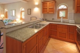 Kitchen with granite tops and stainless steel appliances