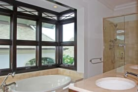 Master bathroom with tub and shower