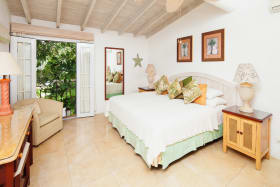 Spacious bedroom has garden views