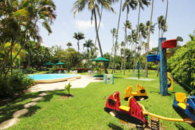 Landscaped grounds, pool and childrens playground at Glitter Bay