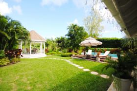 Well landscaped gardens and poolside gazebo