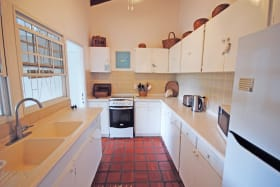 Kitchen opens to dining veranda