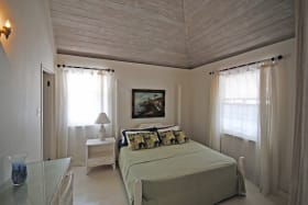 One of the bedrooms in the upper apt