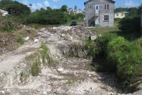 Excavated pool behind the third building