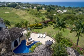 Aerial view of house and coast line