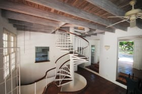 Spiral staircase leads to bedrooms