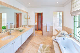 Huge master bathroom with open air shower and separate tub