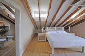 Loft bedroom with ensuite bathroom