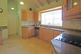 Kitchen opening onto laundry room