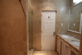 Master bathroom with walk in shower and tub