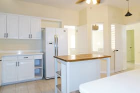 Kitchen with good cupboard space and moveable center island