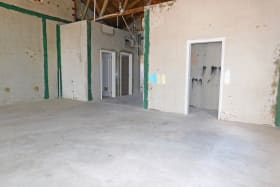Open area with two bathroom cubicals