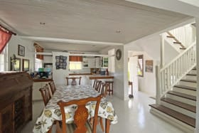 Open plan dining and kitchen areas