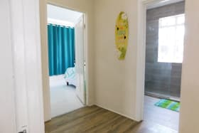 Hallway to the three bedrooms