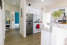 Kitchen outfitted with large fridge and stove